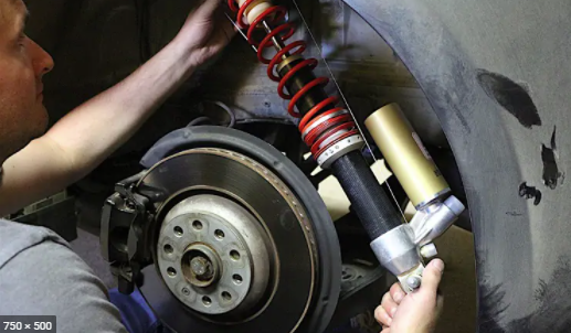 installing new shock absorber replacement