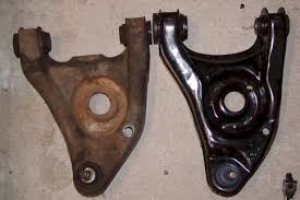 new and old lower control arm