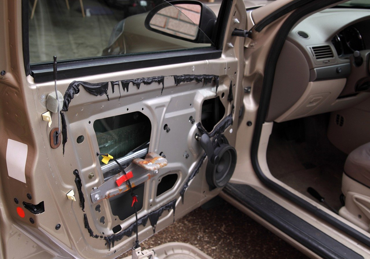 car door with the panel removed to access the regulator mechanism