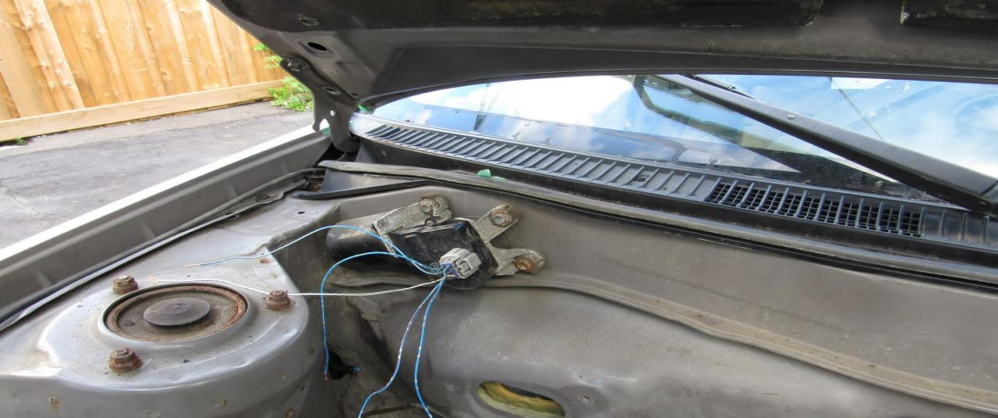 windshield wiper motor location in a 2001 Toyota Corolla