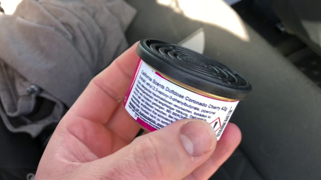 can car air freshener showing the adjustable lid