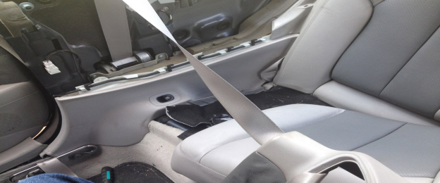 a seat belt won't retract if the retractor spring is damaged