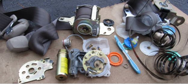 disassembled seat belt assembly