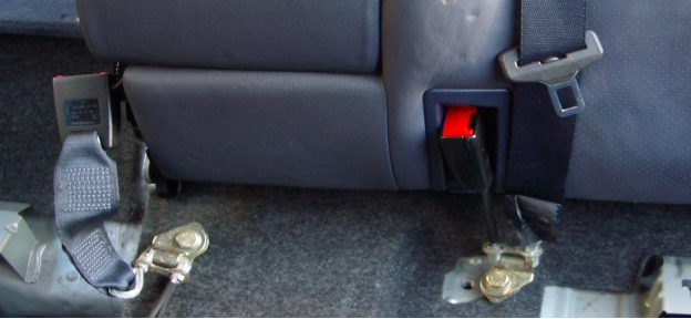 seat belt mounting bolts on a rear seat